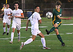 WATERBURY  CT. - 14 October 2019-101419SV15- #7 Brian Silva of Holy Cross takes a shot on goal as #5 Manny Silva of Naugatuck High defends during NVL Soccer action in Waterbury Monday. Steven Valenti Republican-American
