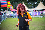 © Joel Goodman - 07973 332324. 06/08/2017 . Macclesfield , UK . A member of stage security team dances to Junior Marvin's Wailers at the Rewind Festival , celebrating 1980s music and culture , at Capesthorne Hall in Siddington . Photo credit : Joel Goodman