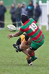 Sosefo Kata gets the pass away as he gets tackled by Caleb Brown.  Counties Manukau Premier Club Rugby game between Waiuku and Bombay, played at Waiuku on Saturday July 5th 2010. Waiuku won 59 - 14 after trailing 12 - 14 at halftme.