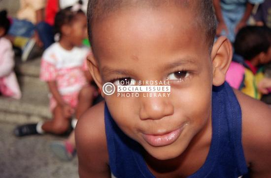 Closeup portrait of nursery school boy in playground in Havana; Cuba,