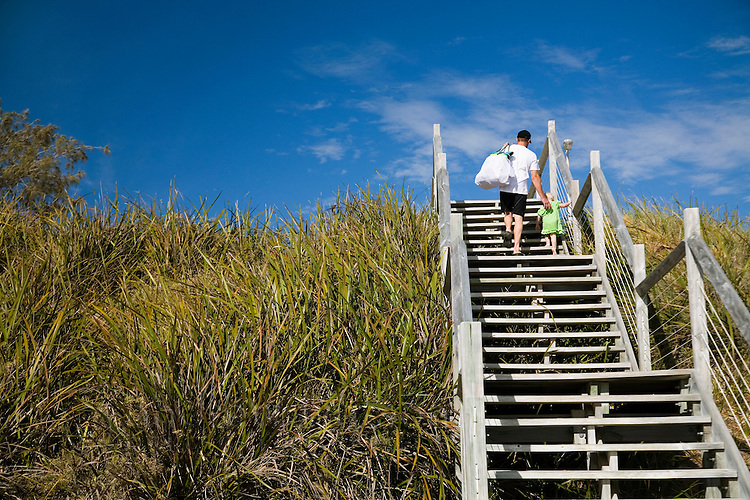 A father walks his daughter up the stairs at Geordie Bay on Rottnest Island, Western Australia, AUSTRALIA.