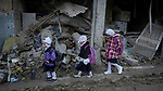 Girls make their way to school amid the rubble of the Old City of Mosul, Iraq, which was devastated during the 2017 Battle of Mosul, which led to the defeat of the Islamic State group, also known as ISIS. During control of the city by the Islamic State, most children didn't attend school.