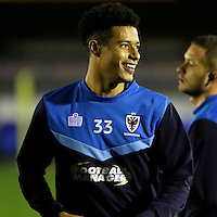 AFC Wimbledon's Lyle Taylor warms up during the The Checkatrade Trophy match between AFC Wimbledon and Brighton & Hove Albion Under 21s at the Cherry Red Records Stadium, Kingston, England on 6 December 2016. Photo by Carlton Myrie / PRiME Media Images
