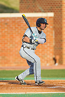 Tyler Chadwick (32) of the Coastal Carolina Chanticleers follows through on his swing against the High Point Panthers at Willard Stadium on March 14, 2014 in High Point, North Carolina.  The Panthers defeated the Chanticleers 3-0.  (Brian Westerholt/Four Seam Images)