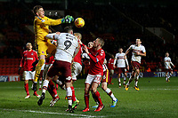 Charlton Athletic goalkeeper, Ben Amos, tries to catch the ball under pressure from Bradford City's Charlie Wyke  during Charlton Athletic vs Bradford City, Sky Bet EFL League 1 Football at The Valley on 13th February 2018