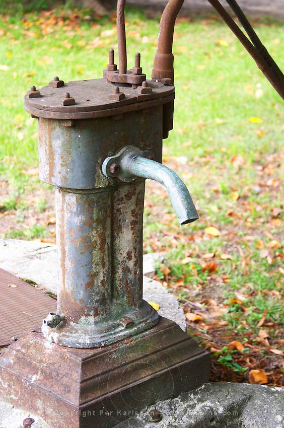 A water pump in the court yard. Chateau de Cerons (Cérons) Sauternes Gironde Aquitaine France