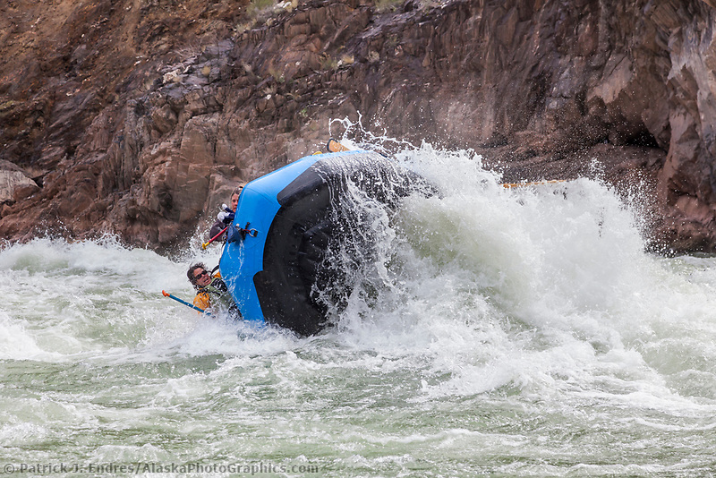 Whitewater raft flips when going through Crystal rapids on the Colorado River in the Grand Canyon National Park, Arizona