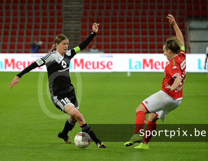 20151007 - LIEGE , BELGIUM : Standard 's  Maud Coutereels (R) and Frankfurt's Kerstin Garefrekes (L)  pictured during the female soccer match between STANDARD Femina de Liege and 1. FFC Frankfurt , in the 1/16 final ( round of 32 ) first leg in the UEFA Women's Champions League 2015 in stade Maurice Dufrasne - Sclessin in Liege. Wednesday 7 October 2015 . PHOTO DAVID CATRY