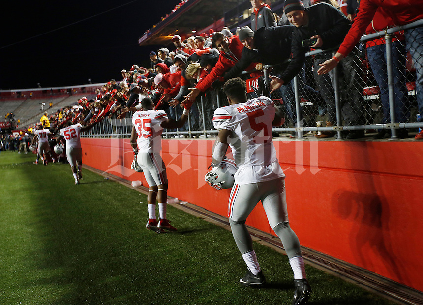 Ohio State Buckeyes linebacker Raekwon McMillan (5) and a line of other Buckeyes celebrate with fans after the college football game between the Rutgers Scarlet Knights and the Ohio State Buckeyes at High Point Solutions Stadium in Piscataway, NJ, Saturday night, October 24, 2015. The Ohio State Buckeyes defeated the Rutgers Scarlet Knights 49 - 7. (The Columbus Dispatch / Eamon Queeney)