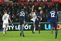 Federico Fernandez of Swansea City and Harry Kane of Tottenham Hotspur contend for the aerial ball during the Premier League match between Swansea City and Tottenham Hotspur at the Liberty Stadium, Swansea, Wales, UK. Tuesday 02 January 2018