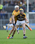 Niall Deasy of Ballyea in action against Cormac O Donovan of Clonlara during their senior county final replay at Cusack Park. Photograph by John Kelly.