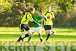 Stan Divane Castleisland goes past Gary Keane Killarney Celtic during their Munster Junior cup clash in Castleisland on Sunday