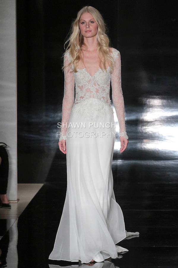 Model walks runway in a Chantilly lace/silk chiffon embroidered gown, from the Reem Acra Spring 2017 bridal collection, during New York Bridal Fashion Week Spring Summer 2017, on April 15, 2016.