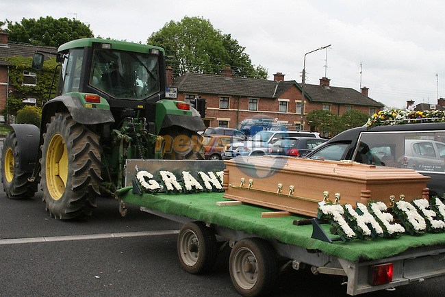Jimmy Winters's coffin being pulled by tractor after his funeral in the Lourdes Church...Photo NEWSFILE/Jenny Matthews.(Photo credit should read Jenny Matthews/NEWSFILE)....This Picture has been sent you under the condtions enclosed by:.Newsfile Ltd..The Studio,.Millmount Abbey,.Drogheda,.Co Meath..Ireland..Tel: +353(0)41-9871240.Fax: +353(0)41-9871260.GSM: +353(0)86-2500958.email: pictures@newsfile.ie.www.newsfile.ie.FTP: 193.120.102.198.