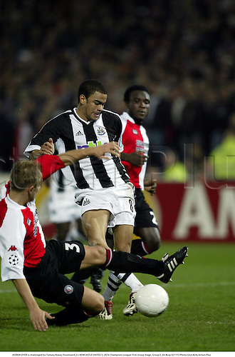 KIERON DYER is challenged by Tomasz Rzasa, Feyenoord 2 v NEWCASTLE UNITED 3, UEFA Champions League First Group Stage, Group E, De Kuip 021113 Photo:Glyn Kirk/Action Plus...Soccer football 2002.tackle tackles......