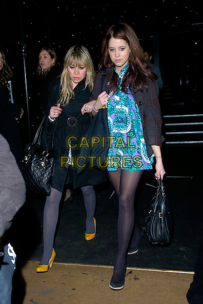 PEACHES GOLDOF & GUEST.LG Shine - launch party, Club Cirque, Leicester Square, London, UK..February 7th, 2007.full length brown tweed jacket purple white green pattern print polka dot dress black bag purse yellow shoes arms linked coat.CAP/CAN.©Can Nguyen/Capital Pictures