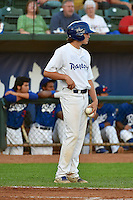 Ogden Raptors batboy stands between innings as the Missoula Osprey played the Ogden Raptors in Pioneer League action on August 4, 2014 at Lindquist Field in Ogden, Utah. (Stephen Smith/Four Seam Images)