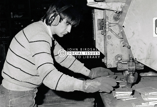 Young man working in industry, UK 1985