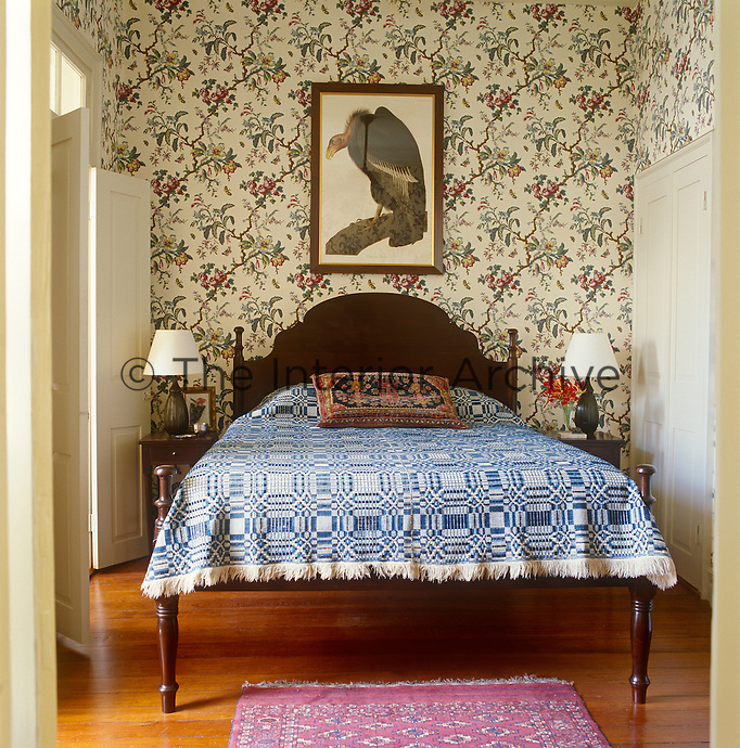A digital print of a California vulture is displayed on the bespoke block-print wallpaper in this bedroom