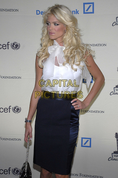 VICTORIA SILVSTEDT.Cipriani and Deutsche Bank present the 2007 Cipriani Wall Street Concert Series, Lenny Kravitz Live, benefiting the U.S. Fund for UNICEF and the Sarah Ferguson Foundation held at Cipriani Wall Street, New York, New York, USA..October 30th, 2007.half length length black blue skirt white sheer blouse bow hand on hip 3/4 .CAP/ADM/BL.©Bill Lyons/AdMedia/Capital Pictures. *** Local Caption ***