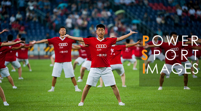 Chinese boys dance on the opening ceremony before the friendly match between Bayern Munich and VfL Wolfsburg as part of the Audi Football Summit 2012 on July 26, 2012 at the Guangdong Olympic Sports Center in Guangzhou, China. Photo by Victor Fraile / The Power of Sport Images