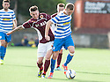 Stenny's Kris Faulds and Morton's Robbie Crawford challenge for the ball .