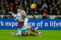 Ki Sung-Yueng of Swansea is blocked by James Collins of West Ham United during the Barclays Premier League match between Swansea City and West Ham United played at the Liberty Stadium, Swansea  on December 20th 2015