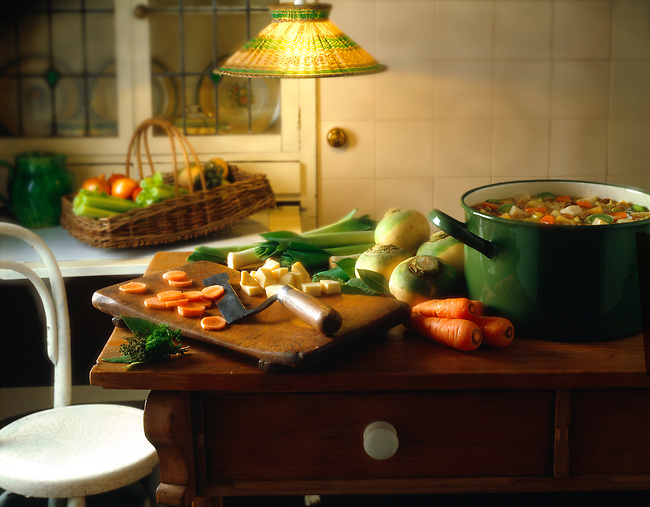 Vegetables being prepared on a cottage kitchen table stock photos