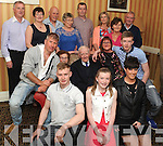 KEY OF THE DOOR: Keith Clifford, (front left), Blackwater, Kenmare ,who celebrated his 21st birthday in the Lansdowne Arms Hotel, Kenmare, with his family and friends on Saturday night.