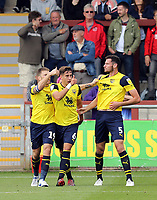 Oxford United's Elliott Moore (right) celebrates with team-mates Jamie Mackie (left) and Alex Gorrin after scoring his sides equalising goal to make the score 1-1<br /> <br /> Photographer Rich Linley/CameraSport<br /> <br /> The EFL Sky Bet League One - Fleetwood Town v Oxford United - Saturday 7th September 2019 - Highbury Stadium - Fleetwood<br /> <br /> World Copyright © 2019 CameraSport. All rights reserved. 43 Linden Ave. Countesthorpe. Leicester. England. LE8 5PG - Tel: +44 (0) 116 277 4147 - admin@camerasport.com - www.camerasport.com
