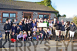 Timmy O'Connor from the Kerry County Hunt Club presents a cheque of EUR1600 to Liam Twomey principal of St Francis Special School Beaufort at their annual hunt in Currow on Sunday .