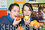 DOUBLE TAKE: Twins Sheonagh and Pataire Fleming  taking part in the Food Dudes programme at Currow National School on Thursday last.    Copyright Kerry's Eye 2008