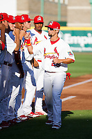 Adam Melker (26) of the Springfield Cardinals high fives teammates as he is introduced prior to a game against the St. Louis Cardinals at Hammons Field on April 2, 2012 in Springfield, Missouri. (David Welker/Four Seam Images)