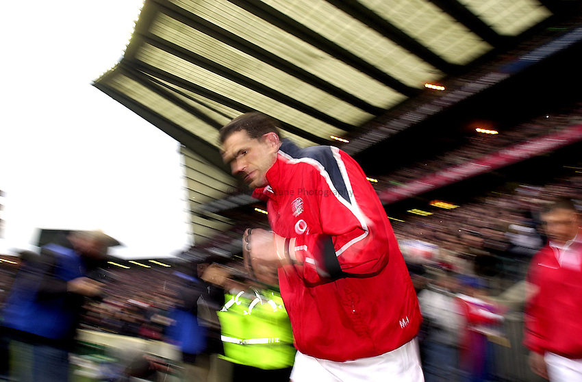 Photo. Richard Lane. .England v France at Twickenham. RBS Six Nations Championship. 15/02/2003.Martin Johnson leads out England.