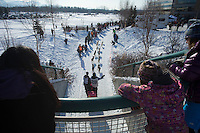 Spectators watch Wade Marrs along the bike/ski trail during the ceremonial start of the Iditarod sled dog race Anchorage Saturday, March 2, 2013. ..Photo (C) Jeff Schultz/IditarodPhotos.com  Do not reproduce without permission