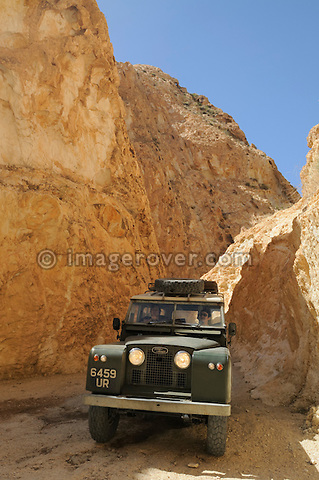 Africa, Tunisia, nr. Saket. Historic Land Rover Series 2a descending through the famous narrow gorge south of Saket. --- No releases available, but releases may not be needed for certain uses. Automotive trademarks are the property of the trademark holder, authorization may be needed for some uses.