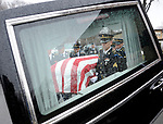 Members of a U.S. Army Honor Guard place the casket containing the remains of Korean War soldier Cpl. Jules Hauterman, Jr. into a hearse during his funeral service in Holyoke on Friday, March 31, 2017. Hauterman, whose remains were newly identified, was a 19-year-old Army medic from Holyoke, who went missing during a bloody Chinese attack on U.S. troops at the Battle of Chosin Reservoir in 1950. Photo by Christopher Evans