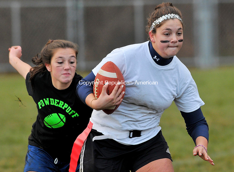 WINSTED, CT-112508JS04-Gilbert junior Courtney Cesca, right, gets caught by senior Nikki Garafalo during their inaugural Powder Puff football game Wednesday at the Gilbert School in Winsted. The money raised from the event will benefit the Gilbert School Student Assistance Fund. The juniors defeated the seniors 28-14.<br /> Jim Shannon / Republican-American