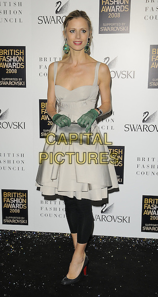 LAURA BAILEY.Inside arrivals at the British Fashion Awards 2008 held at The Lawrence Hall in London, England. UK, .November 25th 2008.full length black leggings grey gray dress top patent shoes green gloves clutch bag .CAP/CAN.©Can Nguyen/Capital Pictures.
