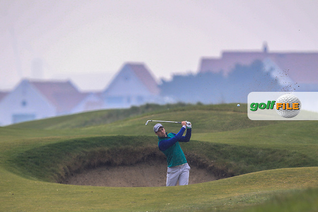 Alex Gleeson (Castle) in a bunker on the 3rd during Round 3 of the Flogas Irish Amateur Open Championship at Royal Dublin on Saturday 7th May 2016.<br /> Picture:  Thos Caffrey / www.golffile.ie