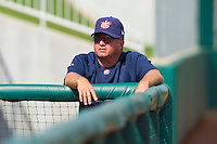 Team USA pitching coach Kirk Champion #44 watches one of his pitchers warm up in the bullpen during the exhibition game against Team Canada at the USA Baseball National Training Center on September 28, 2011 in Cary, North Carolina.  (Brian Westerholt / Four Seam Images)