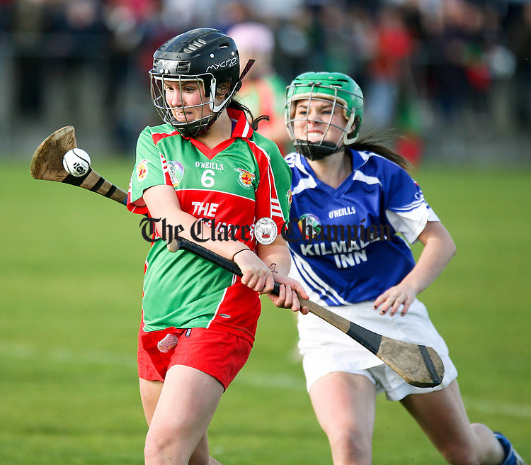 131012.Kilmaleys Aishling Darcy blocks the clearance from Clooney/Quins Orlaith Duggan during their senior Camogie County Final at Clarecastle.