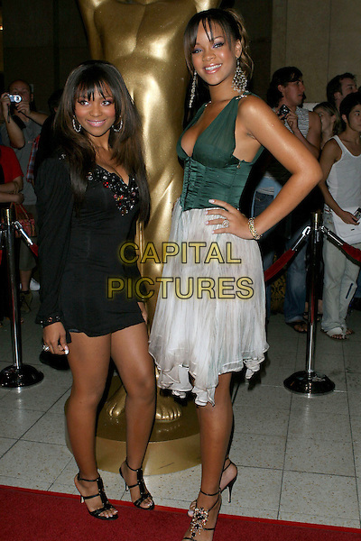 TEAIRRA MARI & RIHANNA.2005 World Music Awards, held at the Kodak Theatre, Hollywood, CA..31st August 2005.half length big gold earrings hands hips green halter neck white skirt dress cleavage black .www.capitalpictures.com.sales@capitalpictures.com.© Capital Pictures.