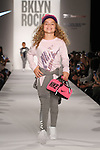 Child models walks runway during the BKLYN ROCKS fashion show at 445 Albee Square in Downtown Brooklyn, on November 09, 2016. Child models walks runway in an outfit by Nike, during the BKLYN ROCKS fashion show at 445 Albee Square in Downtown Brooklyn, on November 09, 2016.