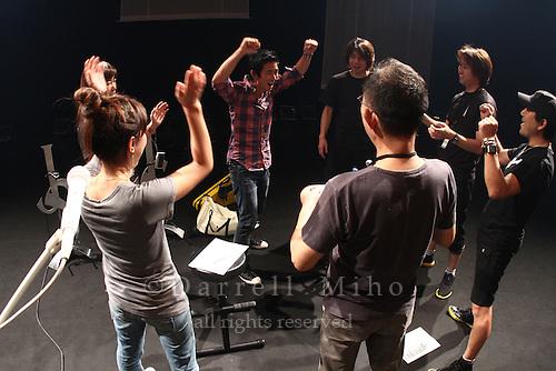 "Aug. 17, 2010 ; Kanazawa, JPN - Jake Shimabukuro meets with his crew prior to his show at the Hokkoku Shimbun Akabane Hall during the ""I Love Ukulele Tour 2010""."