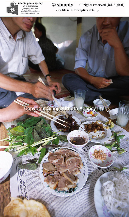Dog meat is eaten in a restaurant by locals in Hanoi. Dogs meat is considered a delicacy in Vietnam with increasing numbers being illegally stolen and shipped across the border from Thailand.