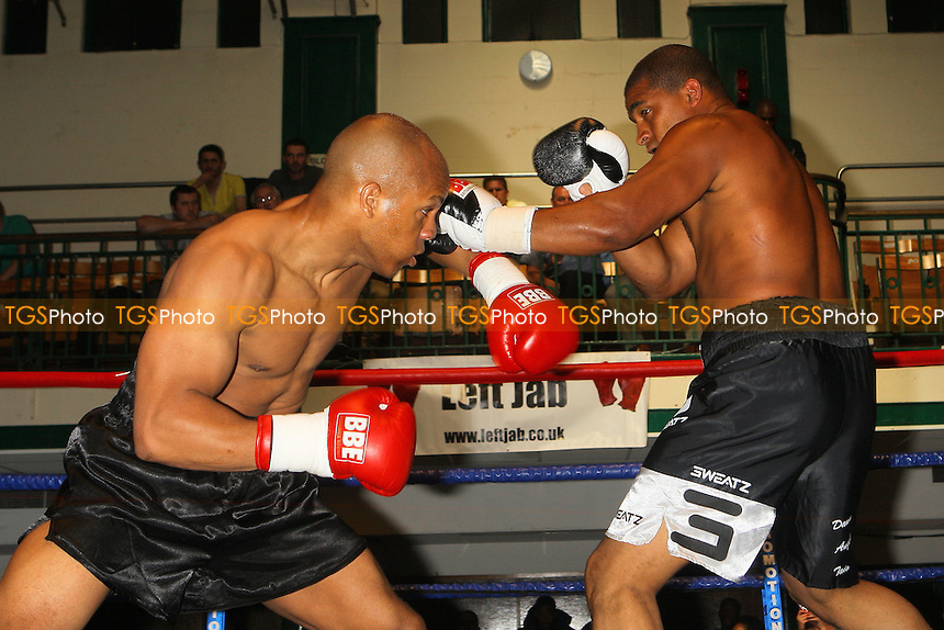 Leon Williams (black shorts) defeats John Anthony (black/white shorts) in a Crusierweight boxing contest at York Hall, Bethnal Green, pormoted by Left Jab / Miranda Carter - 20/06/10 - MANDATORY CREDIT: Gavin Ellis/TGSPHOTO - Self billing applies where appropriate - Tel: 0845 094 6026