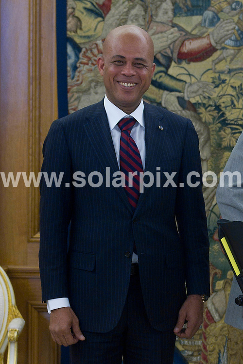 **ALL ROUND PICTURES FROM SOLARPIX.COM**                                             **WORLDWIDE SYNDICATION RIGHTS EXCEPT SPAIN - NO SYNDICATION IN SPAIN**                                                                                  Caption: The King of Spain, Juan Carlos, greets  of president of the republic of Haiti, Michel Joseph Martelly at the Zarzuela Palace, Madrid, Spain. 8 July 2011                                                                This pic: King Juan Carlos and Michel Joseph Martelly                                                                                              JOB REF: 13683 DMS       DATE: 08_07_2011                                                           **MUST CREDIT SOLARPIX.COM OR DOUBLE FEE WILL BE CHARGED**                                                                      **MUST AGREE FEE BEFORE ONLINE USAGE**                               **CALL US ON: +34 952 811 768 or LOW RATE FROM UK 0844 617 7637**