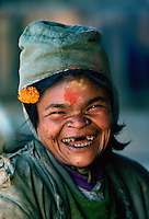 A holy woman laughing at Pashupatinath Hindu Temple in Nepal