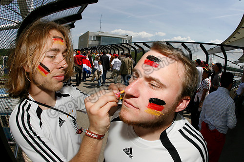 Jun 9, 2006; Munich, GERMANY; German soccer fan Martin Usdrowski applies face paint to friend Robin Wagner, both of Dortmund Germany on the subway platform leading to the stadium on the opening day of the World Cup. Germany plays Costa Rica in Munich and Poland plays Ecuador in Gelsenkirchen in Group A first round action. Mandatory Credit: Ron Scheffler-US PRESSWIRE Copyright © Ron Scheffler